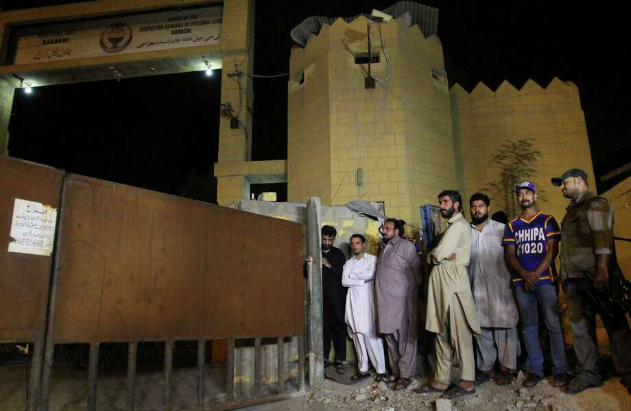 Family members of Shafqat Hussain, who was convicted of killing a boy, wait outside the central prison to receive his body after his execution in Karachi, Pakistan, Tuesday, Aug. 4, 2015. Pakistan has executed Tuesday Hussain, convicted of killing a 7-year-old boy in 2004. Court officials said Thursday that Pakistan had sentenced seven Islamic militants to death over a series of attacks, including an assault on an army-run school that killed more than 150 people. Photo: AP Photo/Fareed Khan / AP