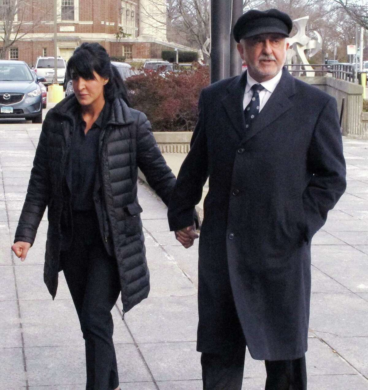 Tiffany Stevens, left, walks with her father, Edward Khalily, to Superior Court on the first day of her trial in Hartford, Conn., Tuesday, Dec. 2, 2014. (AP Photo/Dave Collins)