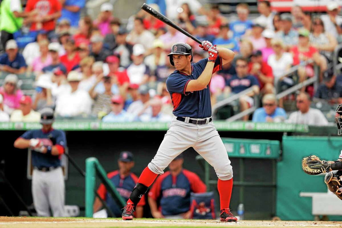 Boston Red Sox third baseman Garin Cecchini bats during the first inning of a spring training game against the Miami Marlins on March 6 in Jupiter, Fla.