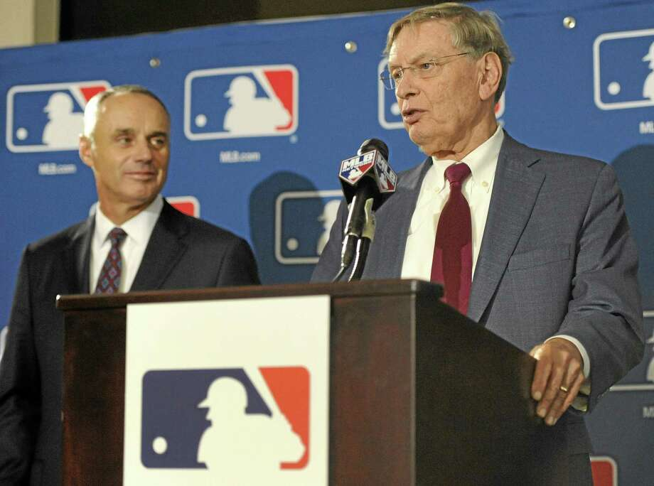 Major League Baseball Commissioner Bud Selig, right, and MMLB Chief Operating Officer Rob Manfred speak to reporters after team owners elected Manfred as the next commissioner during an owners quarterly meeting Thursday in Baltimore. Register sports columnist Chip Malafronte has a few suggestions for Manfred, including speeding up the game, reinstating Pete Rose and bringing back the bullpen car. Photo: Steve Ruark — The Associated Press  / FR96543 AP