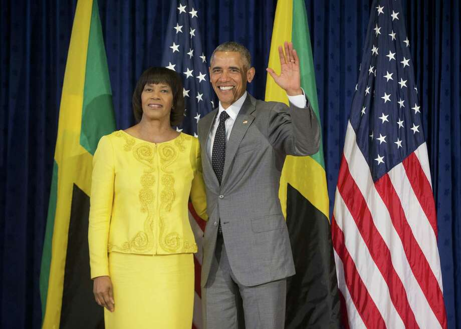 President Barack Obama poses with Jamaican Prime Minister Portia Simpson-Miller prior to their bilateral meeting at the Jamaica House, Thursday, April 9, 2015 in Kingston, Jamaica. (AP Photo/Pablo Martinez Monsivais) Photo: AP / AP