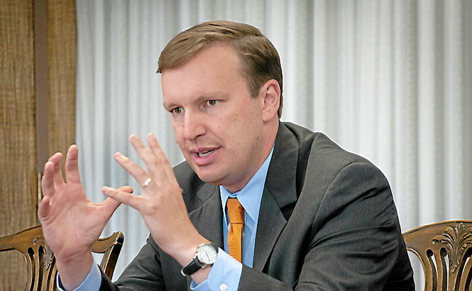 New Haven — Chris Murphy speaks to editorial staff at the New Haven Register.   Melanie Stengel/Register file photo