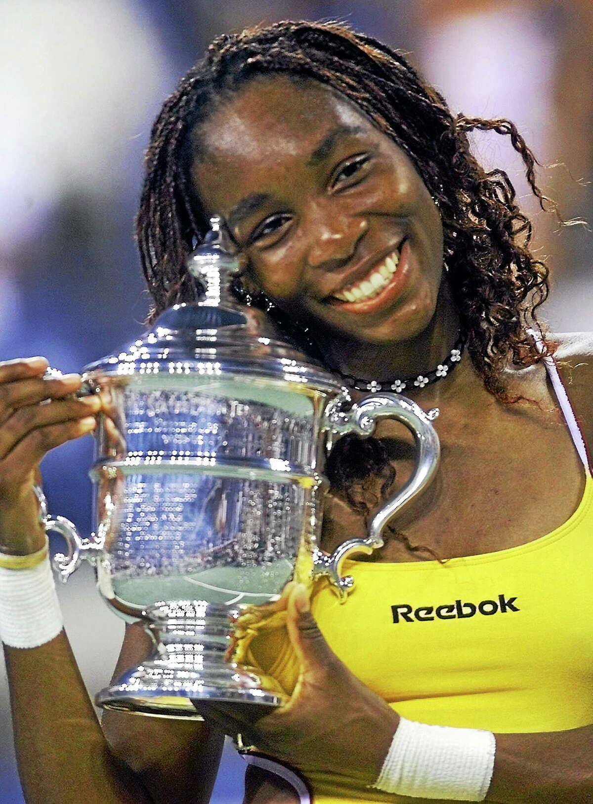 Venus Williams smiles with her trophy after defeating Lindsay Davenport in the U.S. Open final on Sept. 9, 2000, in New York.