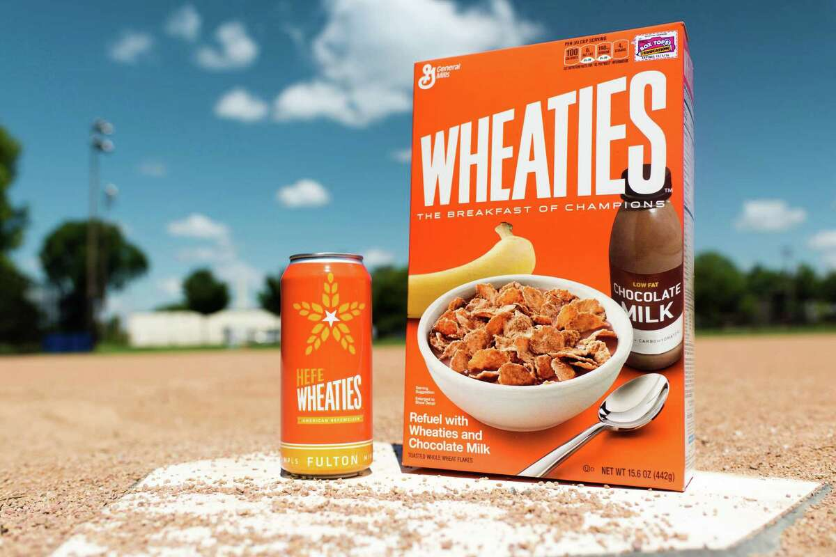 This undated photo provided by General Mills shows a box of Wheaties cereal next to a can of limited-edition HefeWheaties beer. Wheaties said it is partnering with a craft brewery to make the beer.
