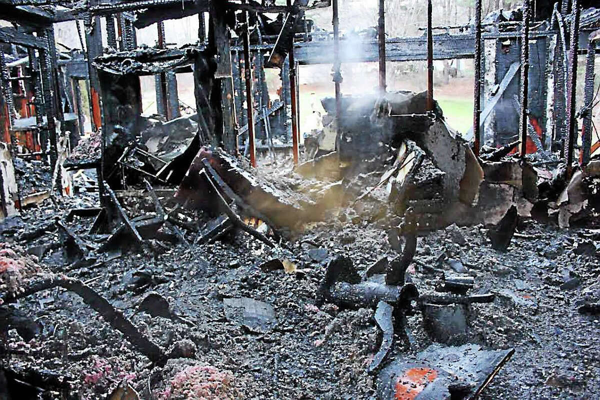 The fire at 151 Killingworth Road, in the Higganum section of Haddam, raged through the three-bedroom ranch early Monday morning, leaving charred rubble in its wake.