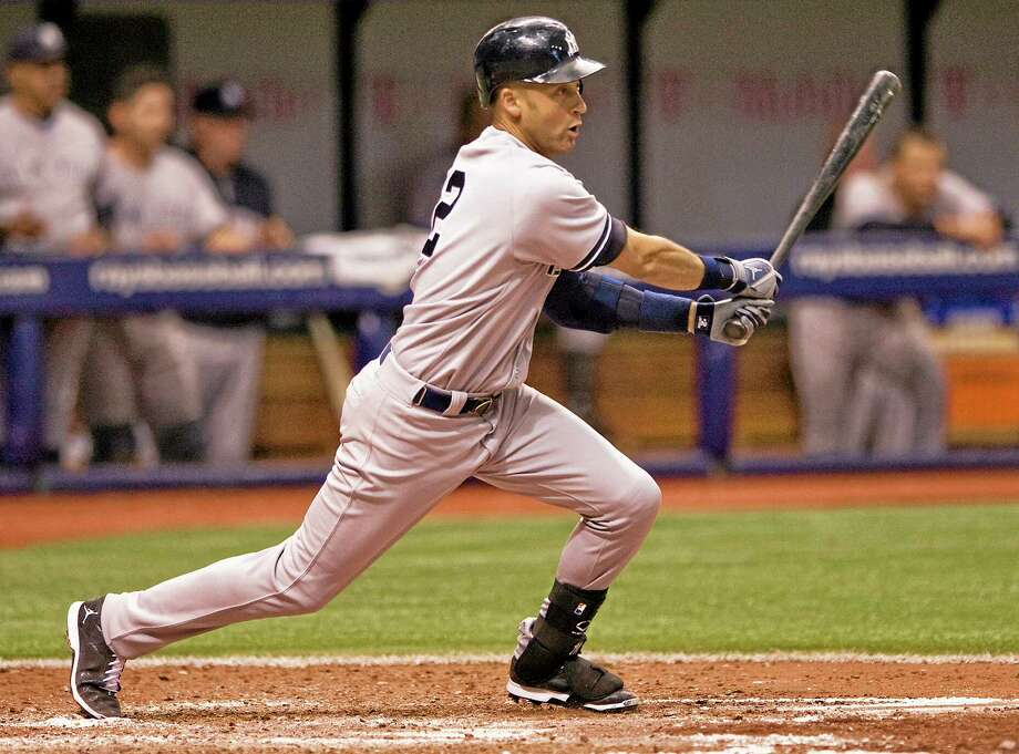 Derek Jeter drove in the go-ahead run against the Rays on Saturday with an RBI single in the ninth inning. Photo: Steve Nesius — The Associated Press  / FR69810 AP