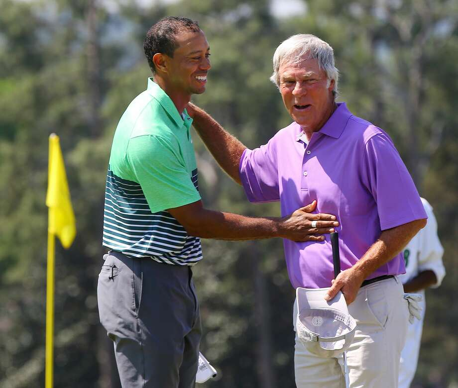 Tiger Woods, left, and Ben Crenshaw embrace on the 18th green as they finish a practice round for the Masters on Wednesday in Augusta, Ga. Photo: Curtis Compton — Atlanta Journal-Constitution  / Atlanta-Journal Constitution