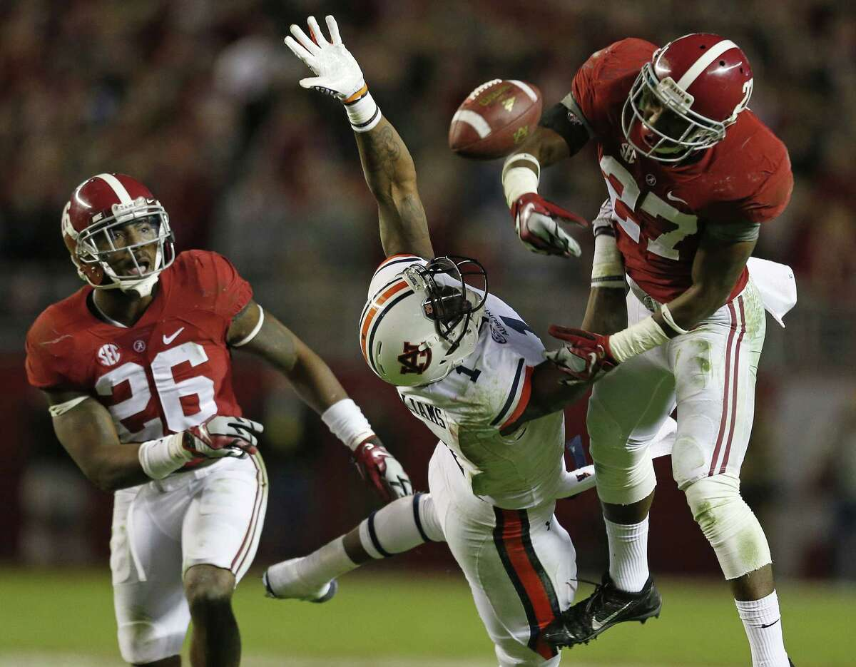 Alabama defensive back Nick Perry (27) breaks up a pass on Auburn wide receiver D'haquille Williams (1) as Alabama defensive back Landon Collins (26) looks on during the second half of the Iron Bowl NCAA college football game, Saturday, Nov. 29, 2014, in Tuscaloosa, Ala. Alabama won 55-44.