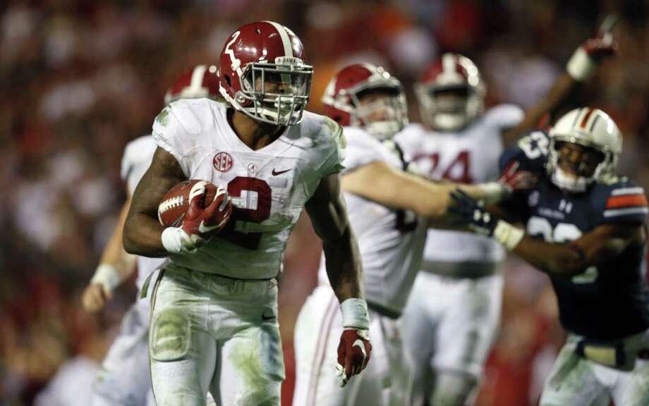 Alabama running back Derrick Henry runs for a touchdown against Auburn on Saturday. Photo: Gerald Herbert — The Associated Press  / AP