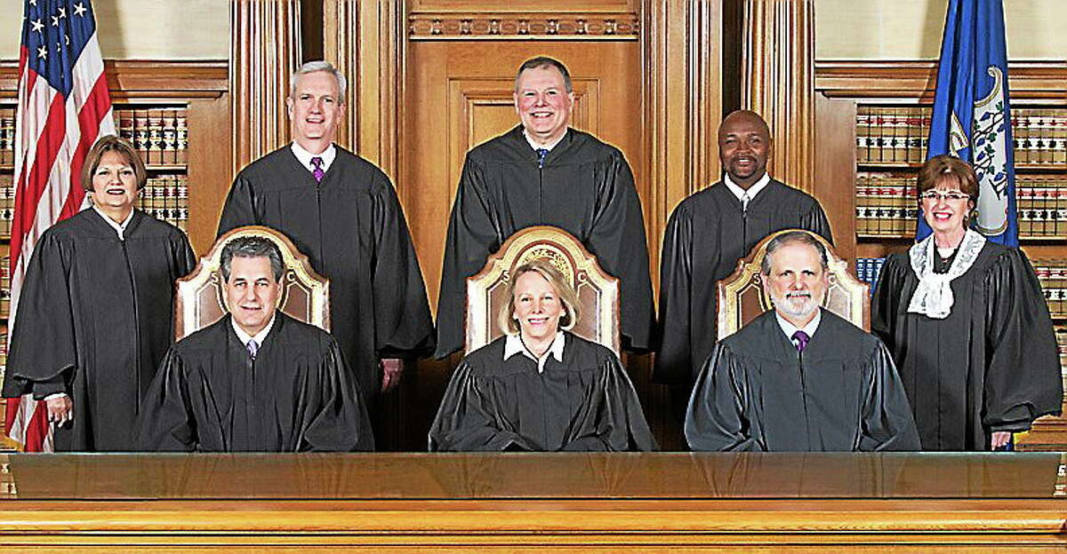 Seated, from left: Justice Richard N. Palmer, Chief Justice Chase T. Rogers, Justice Peter T. Zarella. Standing, from left: Justice Carmen E. Espinosa, Justice Andrew J. McDonald, Justice Dennis G. Eveleigh, Justice Richard A. Robinson, Senior Justice Christine S. Vertefeuille.