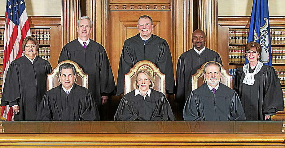 Seated, from left: Justice Richard N. Palmer, Chief Justice Chase T. Rogers, Justice Peter T. Zarella. Standing, from left: Justice Carmen E. Espinosa, Justice Andrew J. McDonald, Justice Dennis G. Eveleigh, Justice Richard A. Robinson, Senior Justice Christine S. Vertefeuille. Photo: Photo From Connecticut Judiciary Website