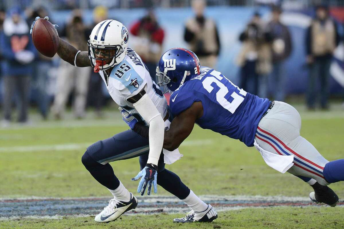 Tennessee Titans wide receiver Nate Washington (85) is defended by New York Giants free safety Stevie Brown (27) in the second half of an NFL football game Sunday, Dec. 7, 2014, in Nashville, Tenn. (AP Photo/Mark Zaleski)
