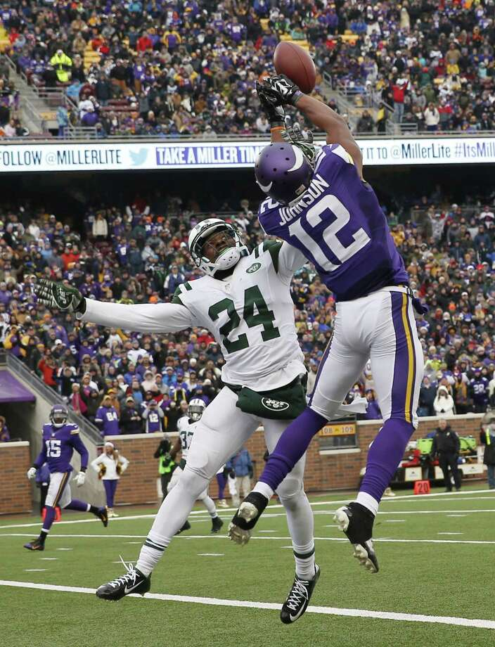 New York Jets cornerback Phillip Adams, left, breaks up a pass in the end zone intended for Minnesota Vikings wide receiver Charles Johnson (12) during the second half of an NFL football game, Sunday, Dec. 7, 2014, in Minneapolis. (AP Photo/Alex Brandon) Photo: AP / AP
