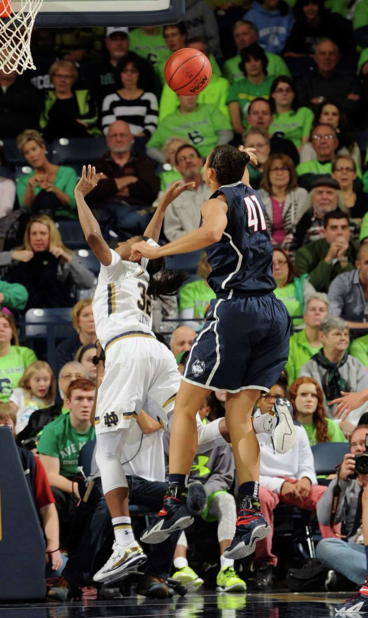 Connecticut forward Kiah Stokes blocks a shot by Notre Dame guard Jewell Loyd, left, in the second half of an NCAA college basketball game with Notre Dame, Saturday Dec. 6, 2014, in South Bend, Ind. Connecticut won 76-58. (AP Photo/Joe Raymond)