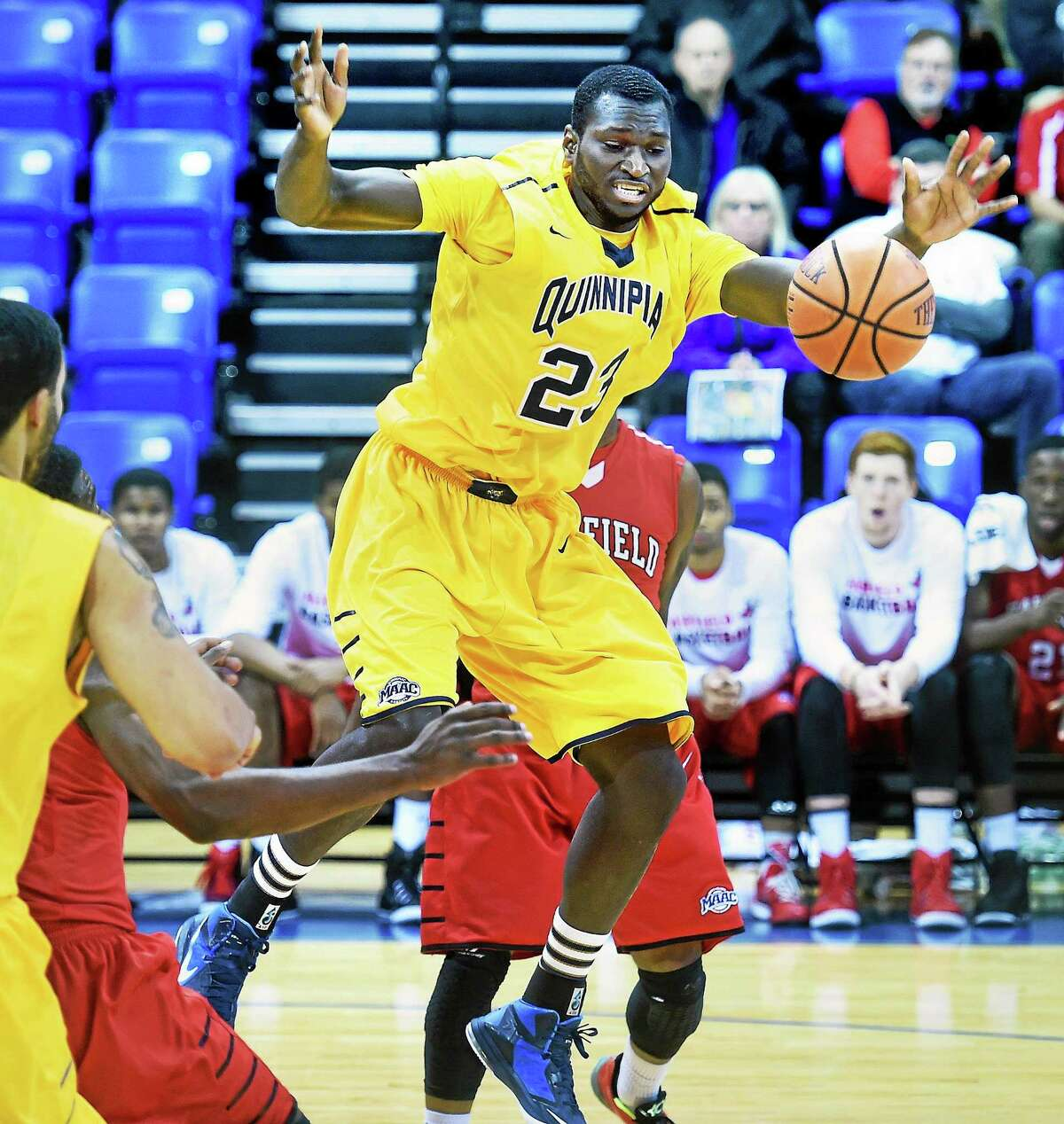 (Arnold Gold-New Haven Register) Ousmane Drame of Quinnipiac University loses the ball in the first half against Fairfield University on 12/7/2014.