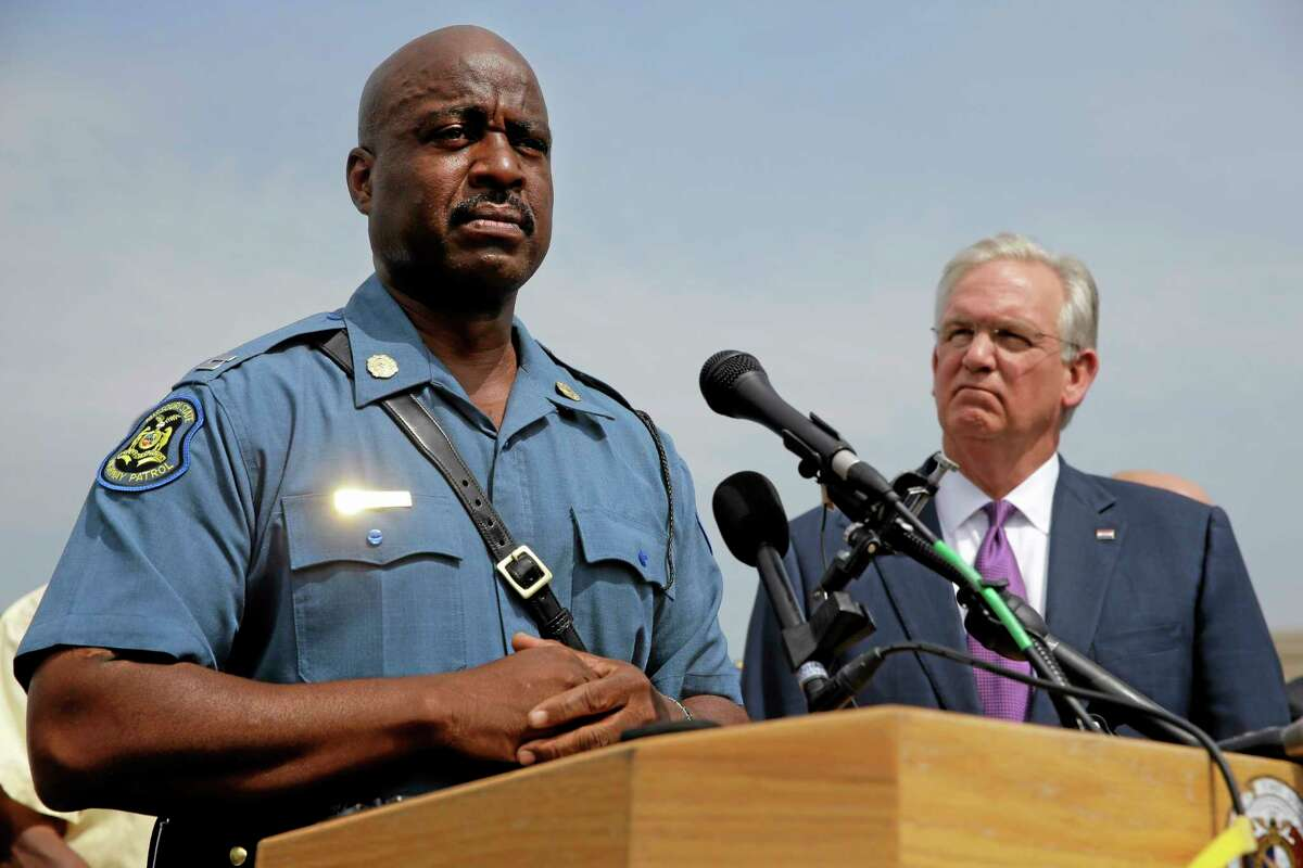 In this Aug. 15, 2014, file photo, Capt. Ron Johnson of the Missouri Highway Patrol, left, and Missouri Gov. Jay Nixon take part in a news conference in Ferguson, Mo. Nixon assigned protest oversight to Johnson after violent protests in Ferguson erupted in the wake of the fatal shooting of Michael Brown by a police officer on Aug. 9.
