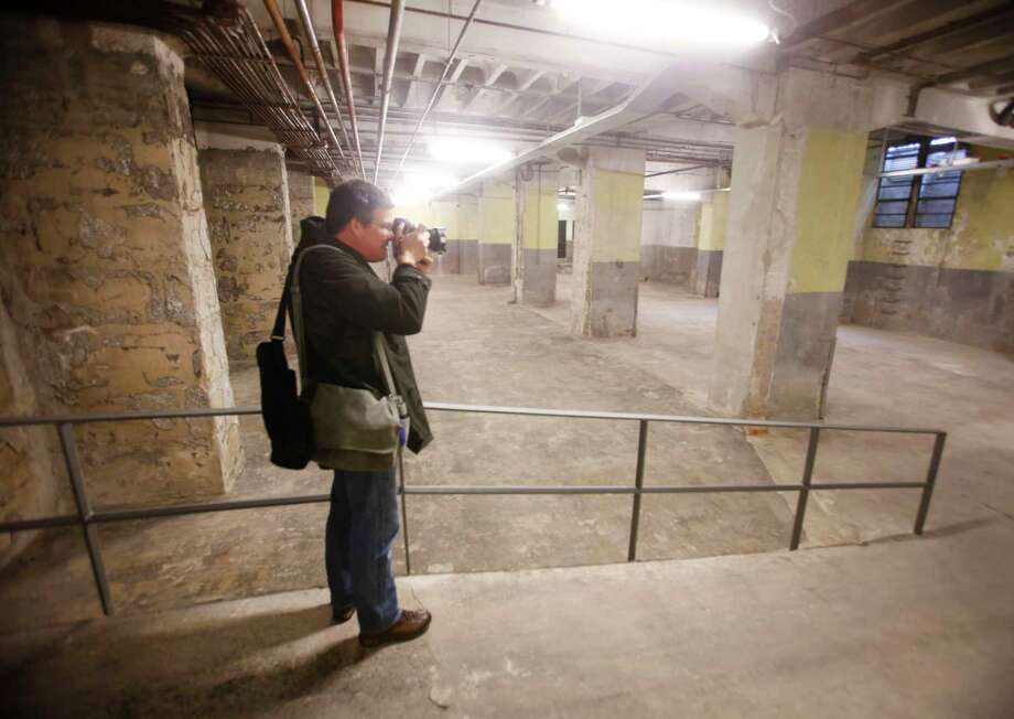 A photographer takes a picture in a cellar which is part of a new holocaust memorial in Frankfurt, Germany, Nov. 20, 2015. The memorial that was shown for first time to the media is located under the new headquarters of the European Central Bank. Hundreds of Jews had to gather in that basement under a former market hall waiting for deportation to various concentration camps. Photo: AP Photo/Michael Probst   / AP