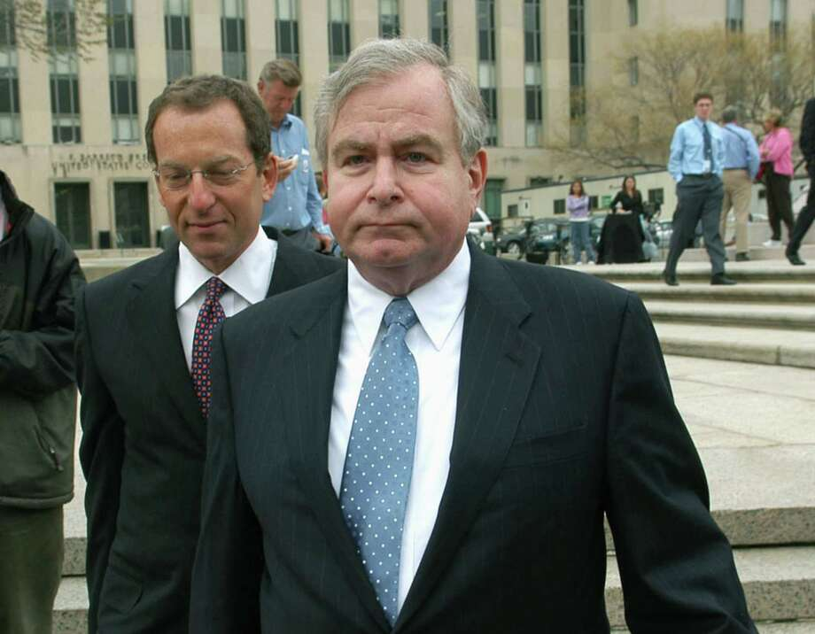 In this April 1, 2005 file photo, Sandy Berger, who was President Clinton's top national security aide, leaves the U.S. District Court House in Washington. A spokesman for his firm says that Berger, who helped craft President Bill Clinton's second term foreign policy and got in trouble over mishandling classified documents, died Wednesday. Photo: AP Photo/Kevin Wolf, File   / AP