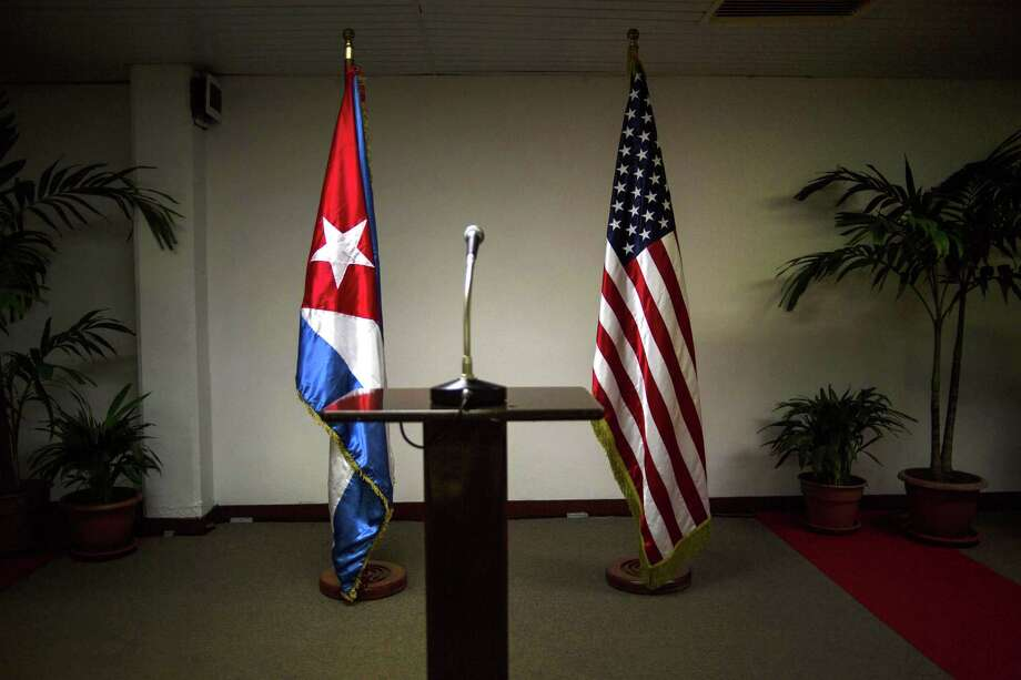 In this Jan. 22 file photo, a Cuban and U.S. flag stand before the start of a press conference on the sidelines of talks between the two nations in Havana, Cuba. The U.S. hopes to open an embassy in Havana before presidents Barack Obama and Raul Castro meet at a regional summit in April, which will be the scene of the presidentsí first face-to-face meeting since they announced on Dec. 17 that they will re-establish diplomatic relations after a half-century of hostility. Photo: AP File Photo  / AP