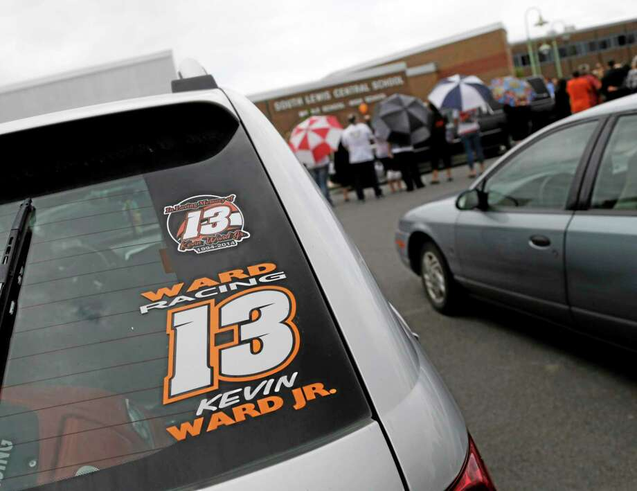 A Kevin Ward Jr. racing sticker is displayed on a vehicle outside South Lewis Central School after Ward's funeral on Thursday in Turin, N.Y. Photo: Mike Groll — The Associated Press  / AP