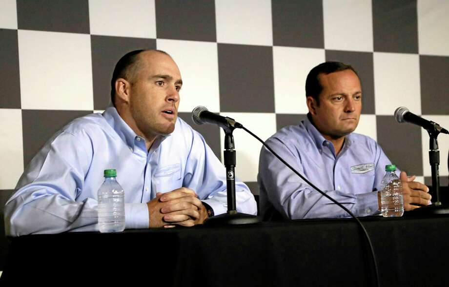 Stewart-Haas Racing executive vice president Brett Frood, left, speaks during a news conference as crew chief Greg Zipadelli looks on Friday at Michigan International Speedway in Brooklyn, Mich. Photo: Brian Smith — The Jackson Citizen Patriot  / Jackson Citizen Patriot