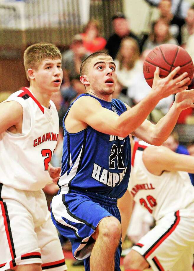 East Hampton senior Matt Vasquenza drives to the basket against Cromwell during Friday's SLC championship game. Vasquenza recently became the 13th player in Bellringers history to score 1000 career points. Photo: John Vanacore — Special To The Press  / John Vanacore/Middletown Press