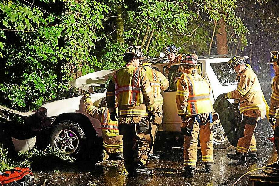 On Route 81 in Higganum Tuesday evening, a car crashed into tree in a heavy downpour, necessitating the extrication of the victim. Photo: Olivia Drake — Special To The Press