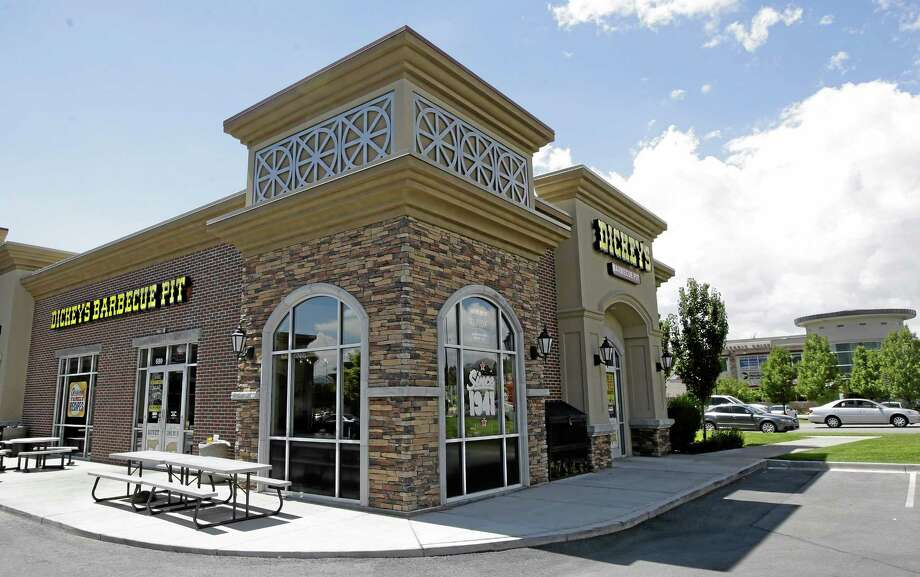 Dickey's Barbecue Pit is shown Thursday, Aug. 14, 2014, in South Jordan, Utah. Police say a woman was in extremely critical condition after drinking sweet tea laced with an industrial cleaning chemical at Dickey's Barbecue Pit. South Jordan Police Cpl. Sam Winkler says the 67-year-old woman was eating at Dickey's Barbecue Pit on Sunday when she poured herself a glass of tea from the beverage bar. Winkler says the woman took a sip and her mouth started burning. (AP Photo/Rick Bowmer) Photo: AP / AP