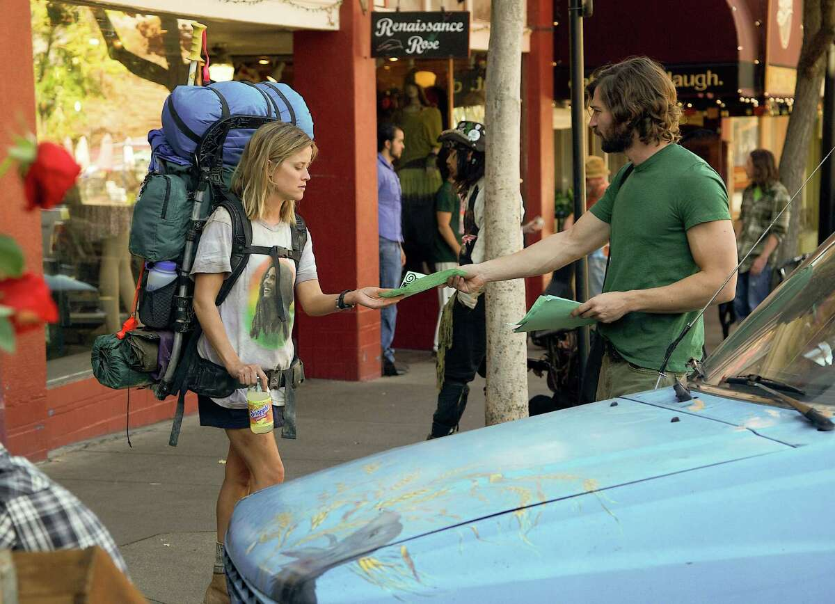 This image released by Fox Searchlight Pictures shows Reese Witherspoon, left, and Michiel Huisman in a scene from the film,