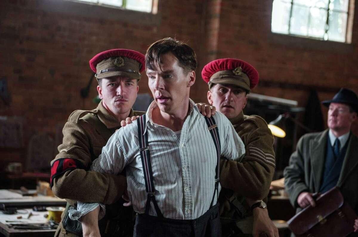 In this image released by The Weinstein Company, Benedict Cumberbatch, center, appears in a scene from