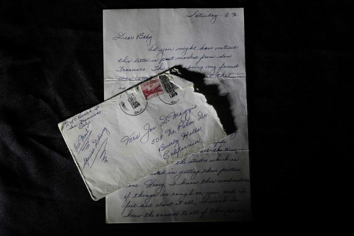 This Friday, Nov. 7, 2014 photo shows part of a three-page handwritten letter and original envelope postmarked Oct. 9, 1954 from baseball legend Joe DiMaggio to Marilyn Monroe on display at Julien's Auctions in Beverly Hills, Calif.