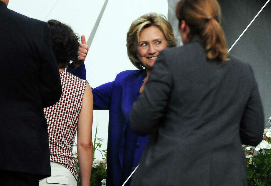 Presidential candidate  Hillary Rodham Clinton gestures with a smile after speaking during a private fundraiser at the home of longtime supporter Virginia McGregor in the Green Ridge section of Scranton, Pa., on Wednesday, July 29, 2015. The event was closed to the media. Photo: Butch Comegys /The Times & Tribune Via AP / The Times & Tribune