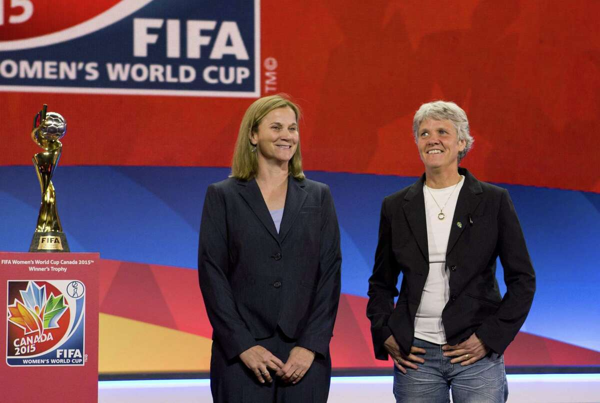 USA national team coach Jill Ellis, left, and Sweden coach Pia Sundhage pose Saturday in Gatineau, Quebec, after the FIFA Women's World Cup draw.