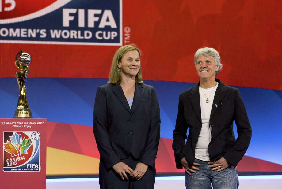 USA national team coach Jill Ellis, left, and Sweden coach Pia Sundhage pose Saturday in Gatineau, Quebec, after the FIFA Women's World Cup draw. Photo: Fred Chartrand — The Canadian Press  / CP