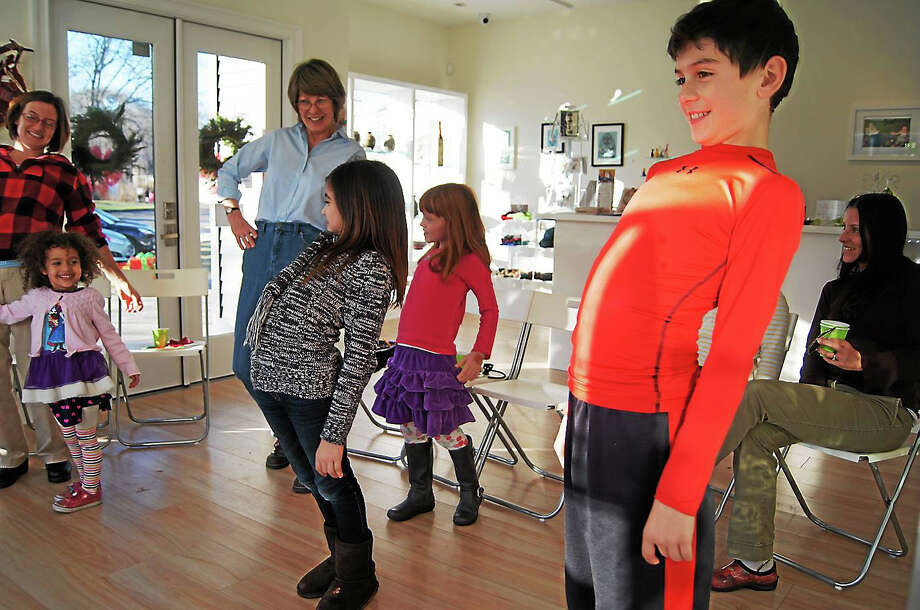 Contributed photos Children take part in a family day activity at Spectrum Art Gallery in Centerbrook. The next family day is Dec. 13. Photo: Journal Register Co.