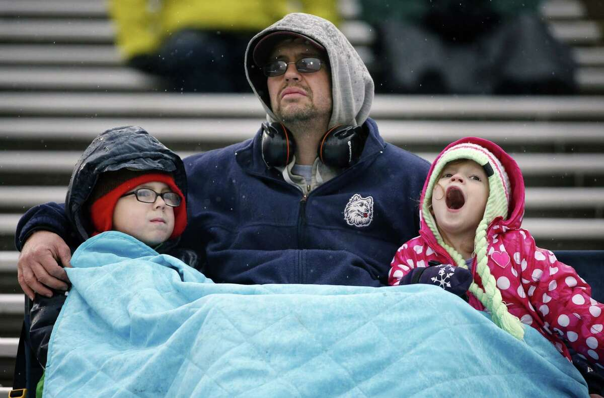 UConn fans watch during the second quarter of the Huskies' 27-20 loss to winless SMU on Saturday afternoon at Rentschler Field in East Hartford.