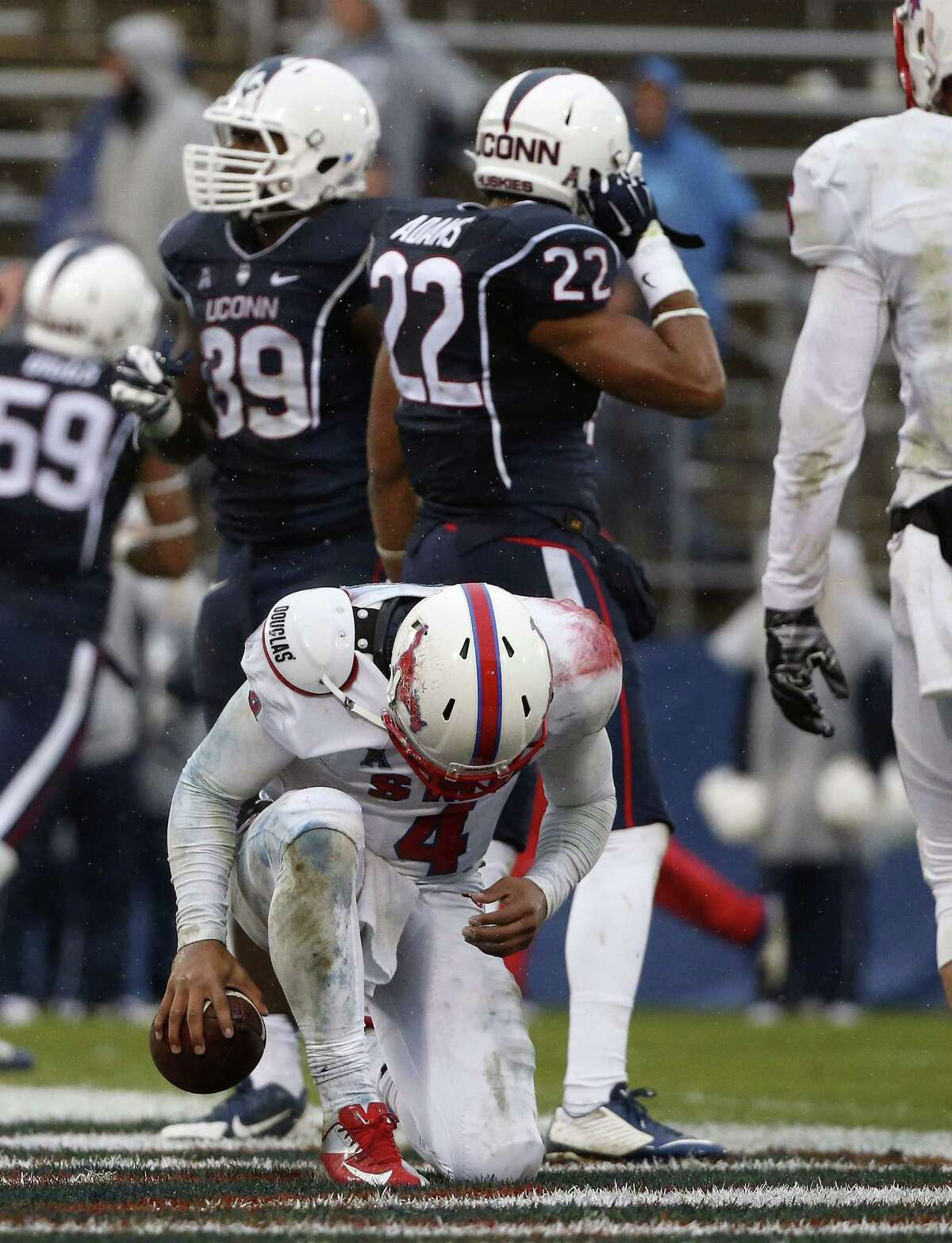 SMU quarterback Matt Davis bows his head after scoring a touchdown during the third quarter of the Mustangs' 27-20 win over UConn on Saturday afternoon at Rentschler Field in East Hartford.