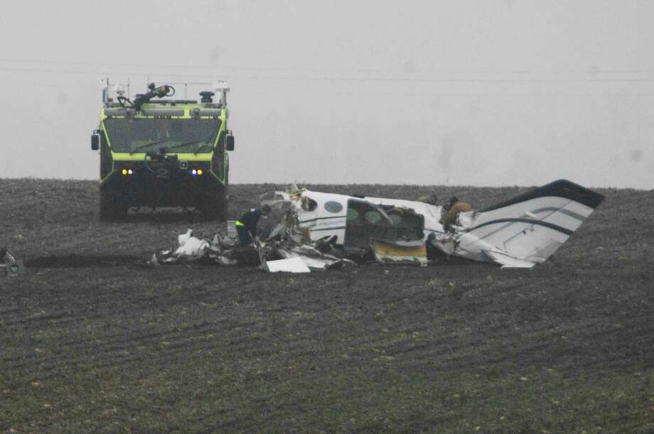 Investigators work at the site of a small plane crash Tuesday near Bloomington, Ill. Photo: David Proeber — The Pantagraph  / The Pantagraph