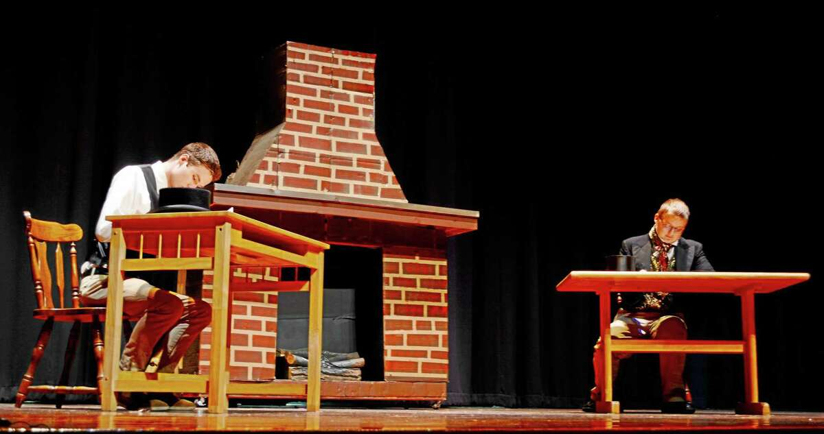 """""""A Christmas Carol"""" begins its two-night run at Mercy High School Thursday at 7 p.m. in Middletown. Here, student actors run through a dress rehearsal of an opening scene."""