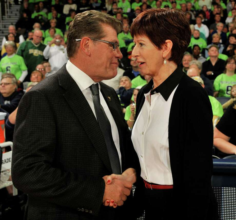 Notre Dame coach Muffet McGraw, right, and UConn coach Geno Auriemma talk before Saturday's game in South Bend, Ind. Photo: Joe Raymond — The Associated Press  / FR25092 AP