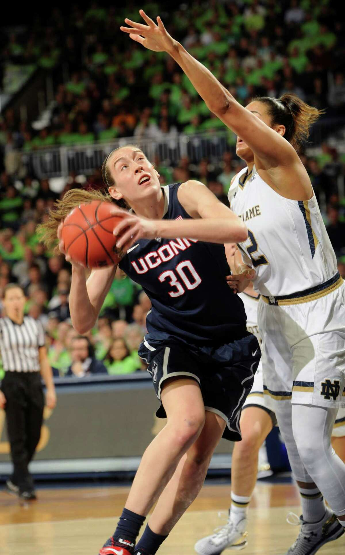UConn's Brenna Stewart drives the lane against Notre Dame's Taya Reimer during the Huskies' 76-58 win on Saturday in South Bend, Ind.