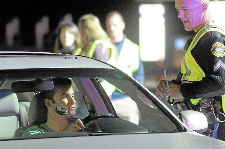 Police officers from five communities conducted a DUI checkpoint on Route 372 in front of the Lowe's home improvement store on Aug. 7 in Cromwell. Photo: File Photo  / © 2013 Tom Kelly IV