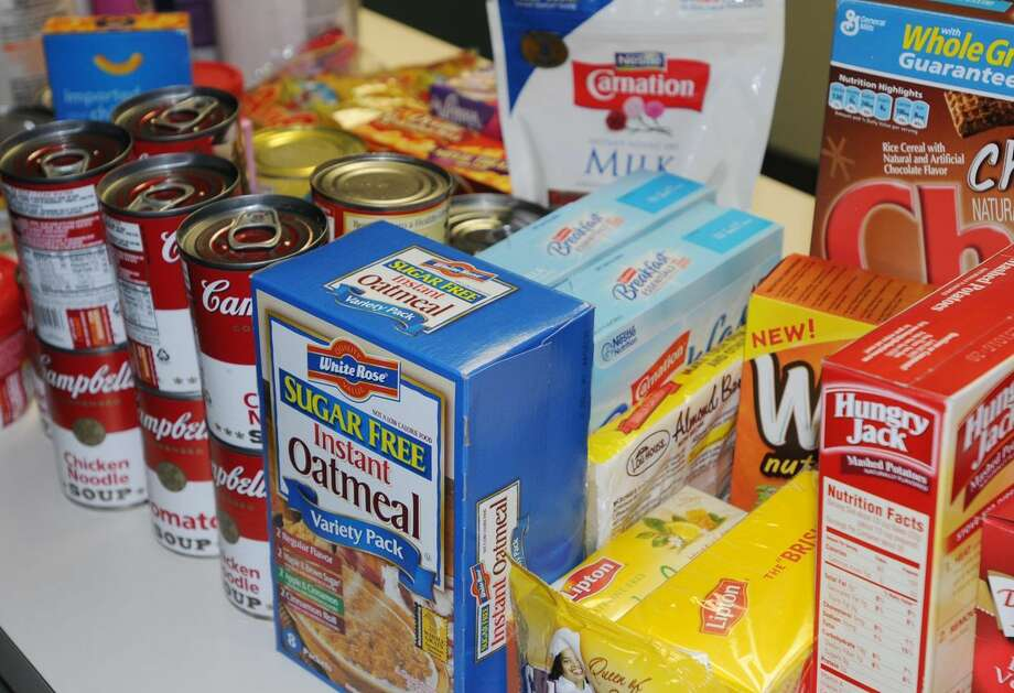 Cromwell police will be collecting donations for the food pantry this weekend, as well as monetary gifts to benefit the town's fuel bank, at Stop & Shop on West Street. Photo: File Photo