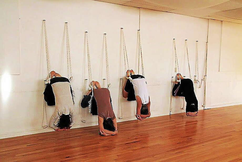 Submitted photo. Guests are shown practicing Iyengar yoga at Yoga in Middletown. The practice places an emphasis on detail, precision and alignment in the performance of posture and breath control using wall ropes. Such will be offered during a series of workshops at the 438 Main Street studio starting this month. Photo: Journal Register Co.