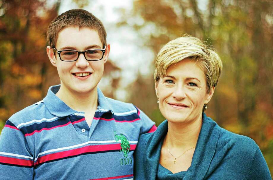 """Leslie Jermainne and son Brian. """"I always thought being an author would be so great, but this book began by getting blindsided with Brian's diagnosis,"""" she says. Photo: Photo By Emily Kaar"""