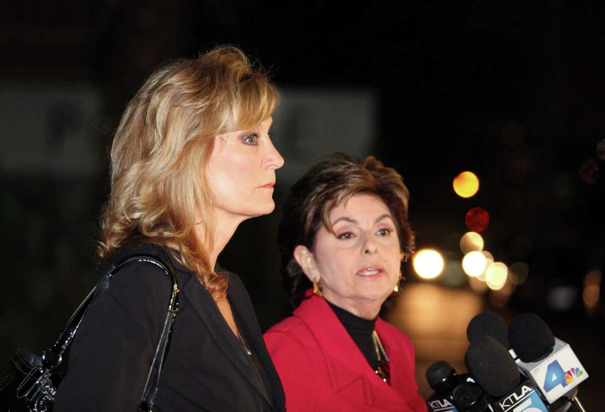 Judy Huth, left, appears at a press conference with attorney Gloria Allred outside the Los Angeles Police Department's Wilshire Division station Friday Dec. 5, 2014. Allred announced that they have met with Los Angeles police detectives to open a formal investigation into claims Bill Cosby molested Huth when she was 15 years old in a bedroom of the Playboy Mansion. (AP Photo/Anthony McCartney)