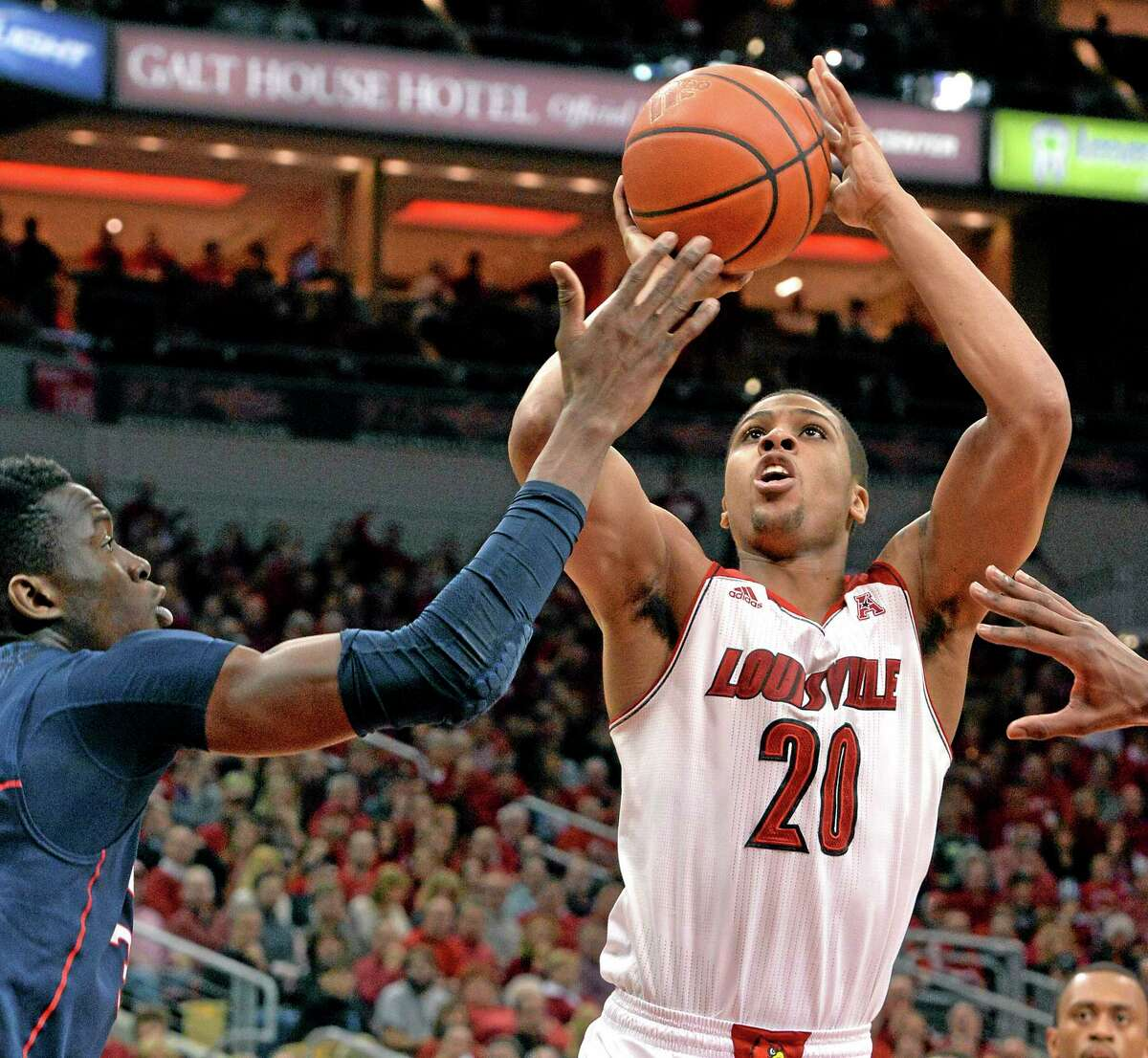 Louisville's Wayne Blackshear shoots as UConn's Amida Brimah defends during the second half of the No. 11 Cardinals' 81-48 win over the 19th-ranked Huskies on Saturday in Louisville, Ky.