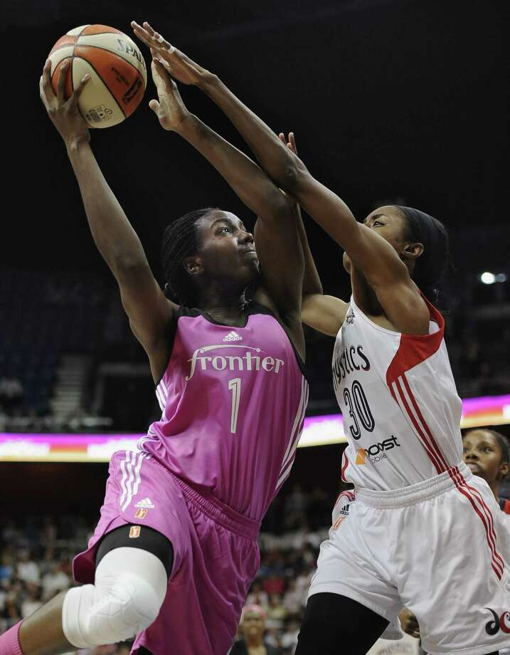 The Connecticut Sun's Elizabeth Williams shoots over the Washington Mystics' LaToya Sanders during Friday's game in Uncasville. Photo: Jessica Hill — The Associated Press  / FR125654 AP
