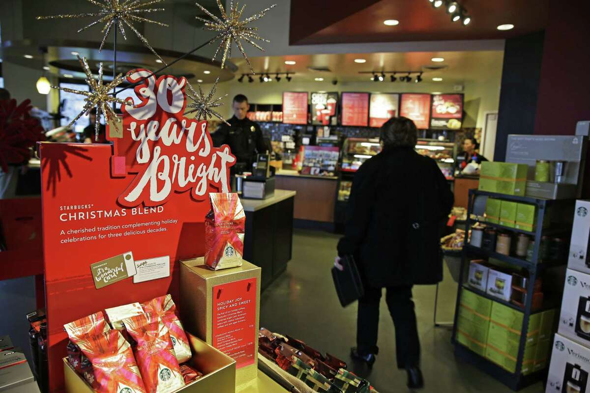 A sign at a Starbucks store advertises the 30th Anniversary of Starbucks' Christmas Blend coffee, in Seattle.