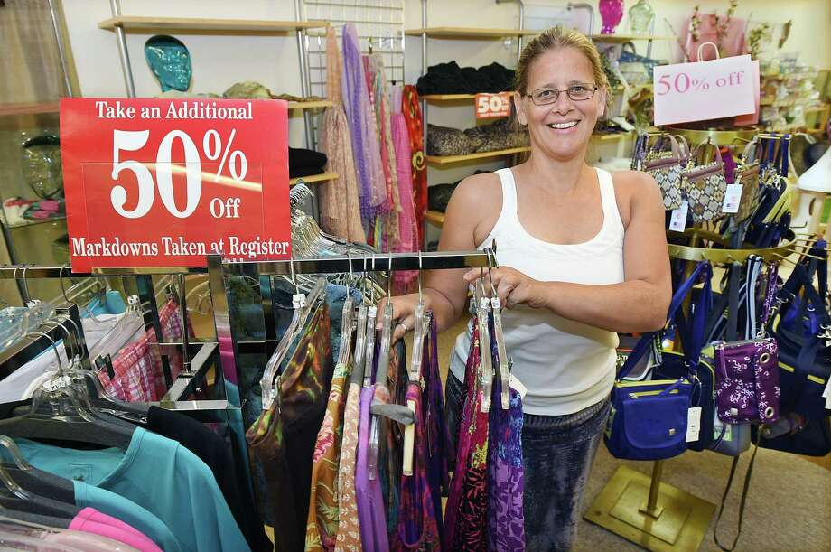 Brigitta Zimmer, owner of Echo Trading Co., is closing her Middletown store at Main Street Market and is offering up to 50 percent off on clothing, jewelry, accessories and gifts. Zimmer opened Echo Trading Co. in Haddam at 1610 Saybrook Road, next to the Cooking Co., a year and a half ago. Photo: Catherine Avalone - The Middletown Press  / The Middletown Press
